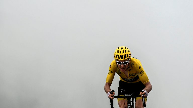 TOPSHOT - Great Britain's Geraint Thomas, wearing the overall leader's yellow jersey, crosses the finish line ta place third of the 17th stage of the 105th edition of the Tour de France cycling race, between Bagneres-de-Luchon and Saint-Lary-Soulan Col du Portet, southwestern France, on July 25, 2018. (Photo by Philippe LOPEZ / AFP) (Photo credit should read PHILIPPE LOPEZ/AFP/Getty Images)