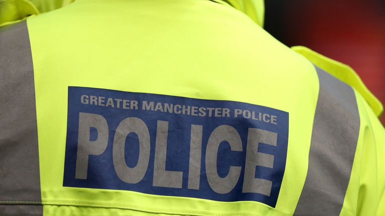 Greater Manchester Police signage on a policeman's jacket
