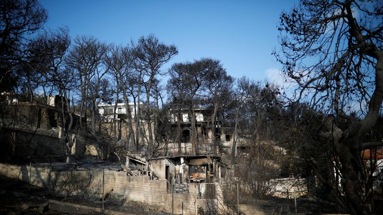 Burnt houses are seen following a wildfire at the village of Mati, near Athens, Greece, July 25, 2018. REUTERS/Alkis Konstantinidis
