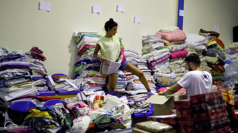 A volunteer arranges clothes for residents of areas that were struck by a wildfire in Nea Makri, near Athens, Greece, July 25, 2018. REUTERS/Alkis Konstantinidis