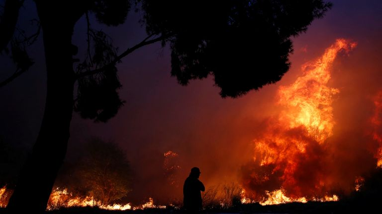 A fire rages in the town of Rafina
