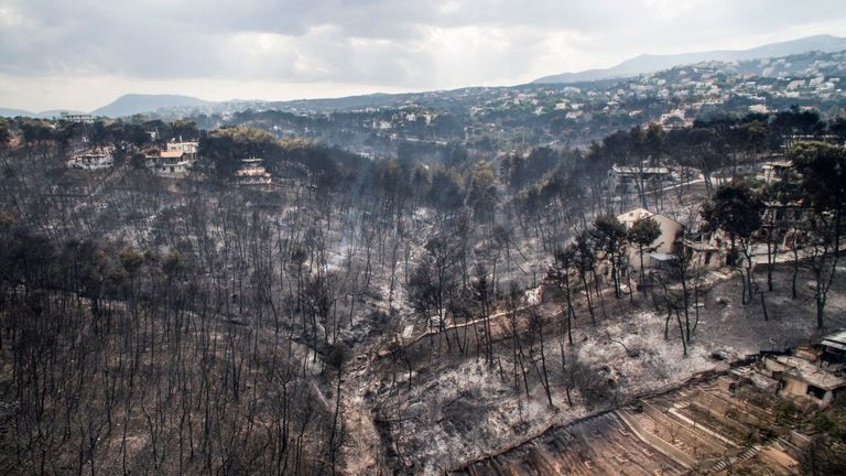 An aerial view shows damage caused by a wildfire near the village of Mati, near Athens