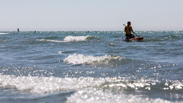 A paddle boarder took to the water as the sun came out in Chichester