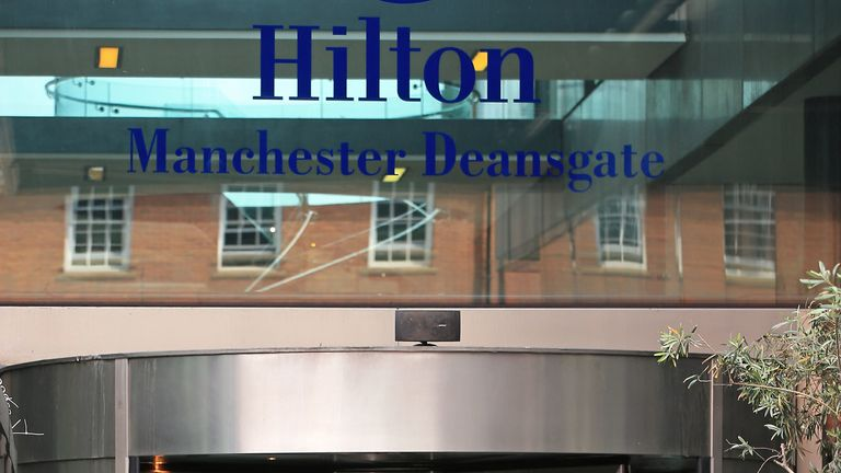 A police officer leaves the Hilton after the stabbing