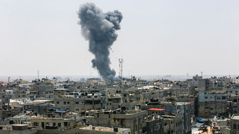 A picture taken on July 14, 2018 shows a smoke plume risisng following an Israeli air strike in the southern Gaza Strip city of Rafah, near the border with Egypt. - Israel's military said it had launched air strikes targeting Hamas in the Gaza Strip on July 14 as rockets and mortars were lobbed into southern Israel from the blockaded Palestinian enclave. (Photo by SAID KHATIB / AFP) (Photo credit should read SAID KHATIB/AFP/Getty Images)