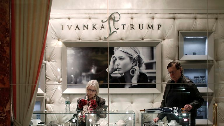 People look at items for sale in the Ivanka Trump shop inside Trump Tower, New York