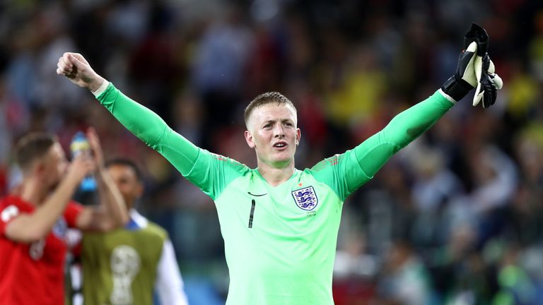 Jordan Pickford celebrates after becoming the hero of England's victory over Colombia