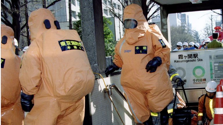 File photo of special chemical control unit members emerging from an entrance to the Kasumigaseki subway station in Tokyo March 20, 1995