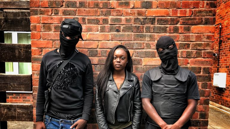 Kumba Kpakima, middle, asked gang members why they got involved in the lifestyle
