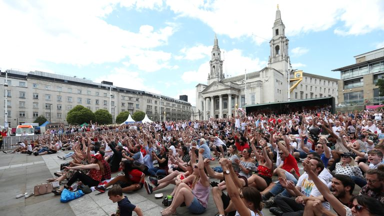 England fans react as they watch the match in Millennium Square, Leeds