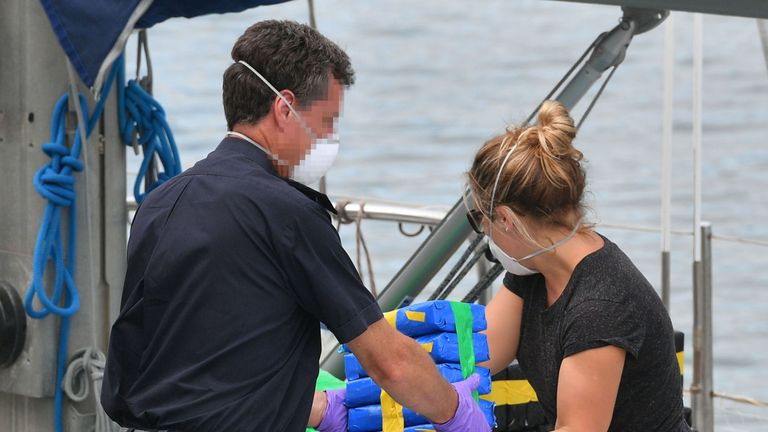 Officers unload drugs from the Marcia sailing yacht