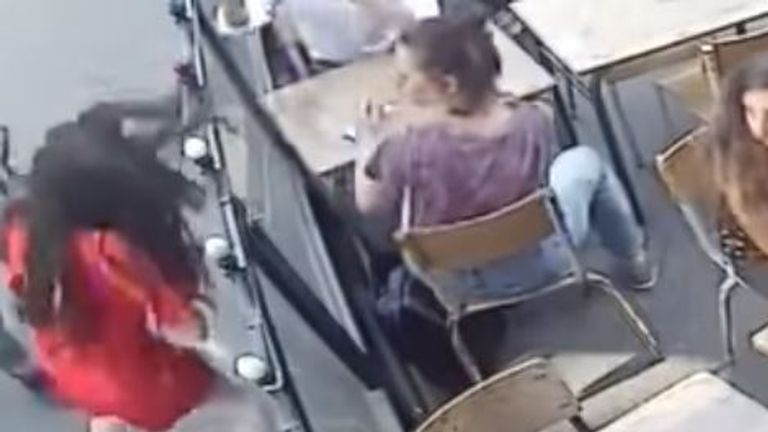 People in the cafe look on in horror as Ms Laguerre  is atacked