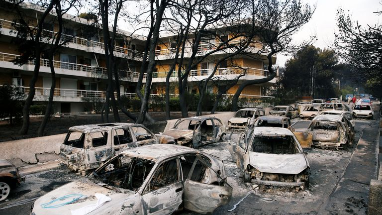 Burned cars are seen following a wildfire at the village of Mati