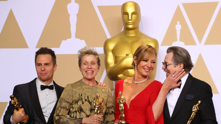 Oscar winners Sam Rockwell, Frances McDormand, Allison Janney and Gary Oldman (L to R) pose backstage. REUTERS/Mike Blake