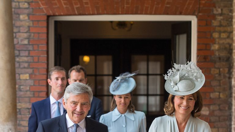 Michael and Carole Middleton walk ahead of Pippa and husband James