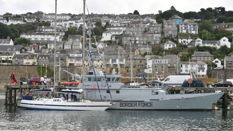 The Border Force cutter HMC Vigilant is seen behind the yacht in Newlyn harbour