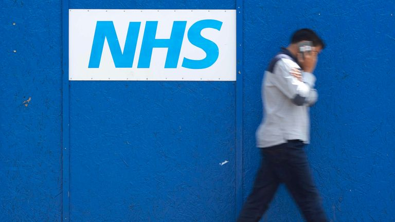 A man walks past an NHS signage outside The Royal London Hospital in London on May 14, 2017. The unprecedented global cyberattack has hit more than 200,000 victims in scores of countries, Europol said on May 14, 2017, warning that the situation could escalate when people return to work. In Britain, the attack disrupted care at National Health Service facilities, including The Royal London Hospital, part of the largest NHS Trust in England. / AFP PHOTO / Niklas HALLE'N (Photo credit should read N