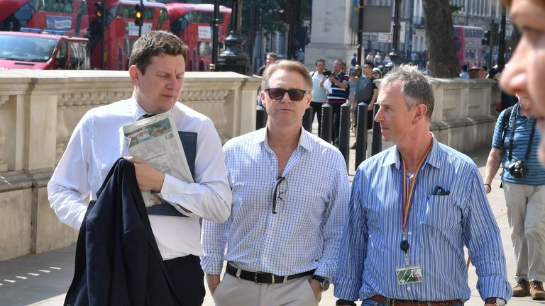 Nigel Evans (R), joint head of the 1922 committee, arriving at a backbenchers meeting after the cabinet agreed on a Brexit plan
