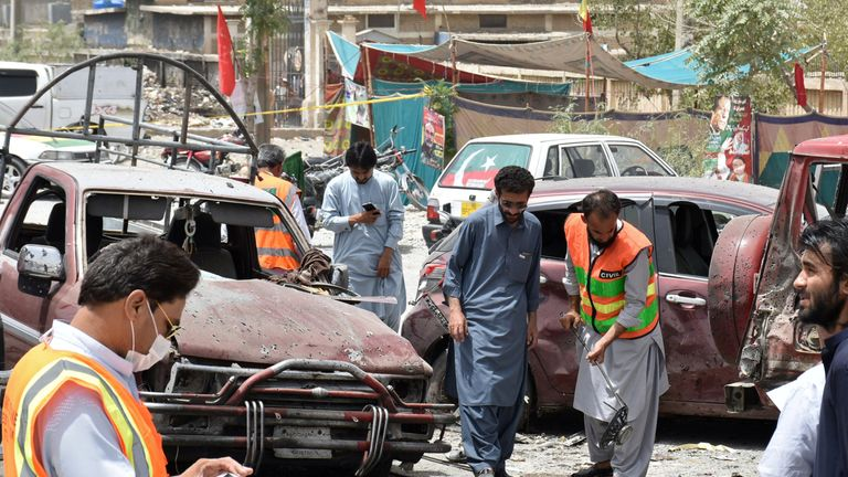 Members of the bomb disposal unit survey the site after a suicide blast, in Quetta