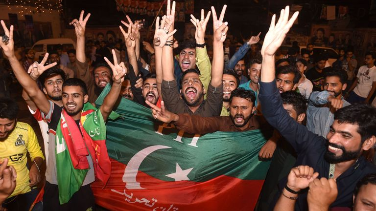 Supporters of Pakistan's cricketer-turned politician Imran Khan, head of the Pakistan Tehreek-e-Insaf (Movement for Justice) party, celebrate in Lahore