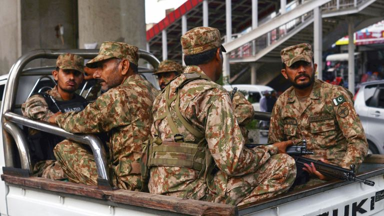 Pakistani soldiers sit on a truck during a patrol on a street in Rawalpindi on July 23, 2018. - Pakistan will hold the general election on July 25