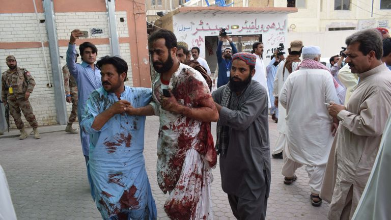 Injured are taken to hospital after a suicide bomber hits Pakistan