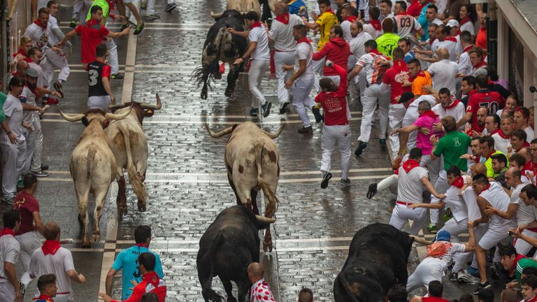 Five people have been badly injured during the first running of the bulls in Pamplona