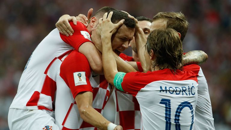 Croatia's forward Ivan Perisic (C) celebrates with his teammates after scoring the 1-1 equalizer during the Russia 2018 World Cup final football match between France and Croatia at the Luzhniki Stadium in Moscow on July 15, 2018. (Photo by Odd ANDERSEN / AFP) / RESTRICTED TO EDITORIAL USE - NO MOBILE PUSH ALERTS/DOWNLOADS (Photo credit should read ODD ANDERSEN/AFP/Getty Images)
