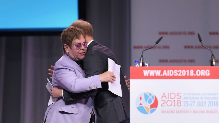 The Duke of Sussex hugs Sir Elton John during the Aids 2018 summit in Amsterdam