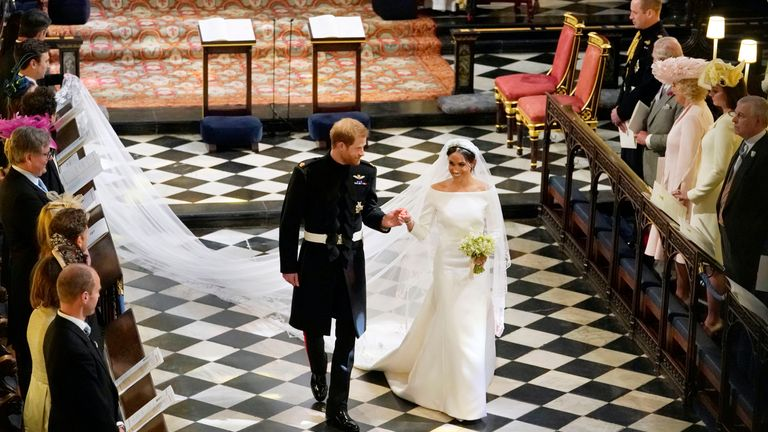 The Duke and Duchess of Sussex leave St George's Chapel after their wedding ceremony
