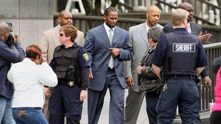 R Kelly, pictured here leaving court during his child pornography trial in 2008, has addressed rumours against him