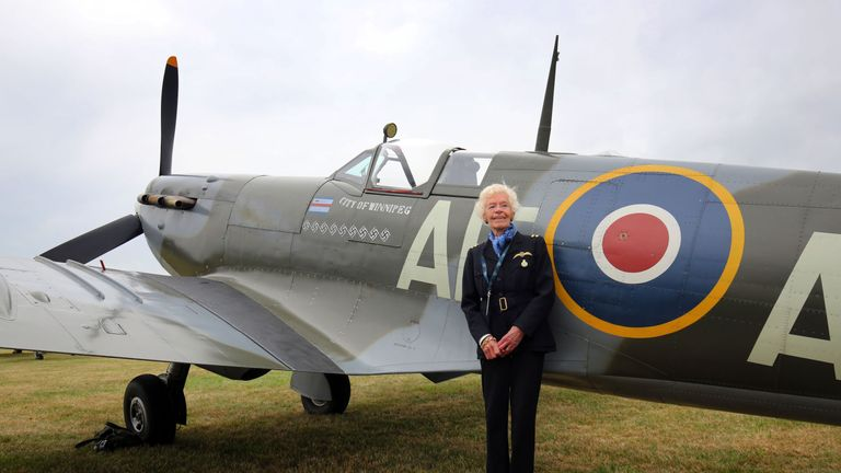 RAF Veteran Mary Ellis looking at a Spitfire at Biggin Hill Airfield in Kent