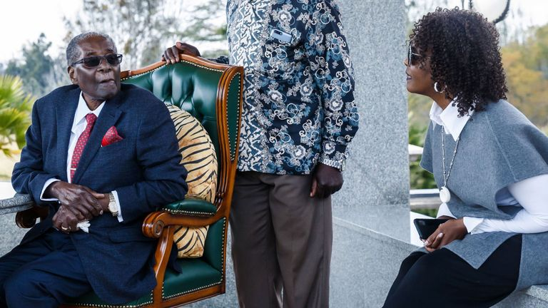 Robert Mugabe speaks with his wife Grace by his side