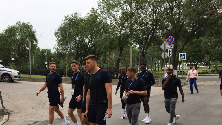 The players were largely silent when they left the hotel for their short stroll