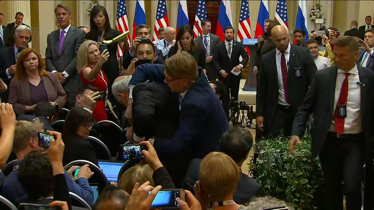Protester being held ahead of Trump and Putin's news conference