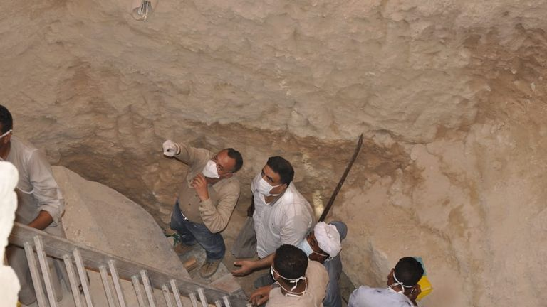 Mostafa Wazir, Secretary General of the Supreme Council of Antiquities, inspects the site of the sarcophagus