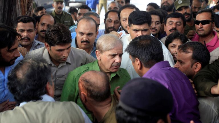 Shehbaz Sharif, brother of ousted Prime Minister Nawaz Sharif and leader of Pakistan Muslim League-Nawaz (PML-N), talks with his supporters on his arrival at a polling station to cast vote during general election in Lahore, Pakistan July 25, 2018. REUTERS/Mohsin Raza
