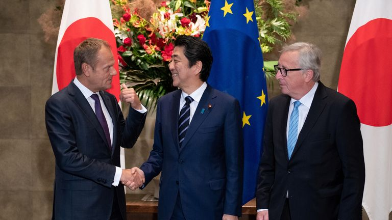 Japanese Prime Minister Shinzo Abe shakes hands with European Council President Donald Tusk