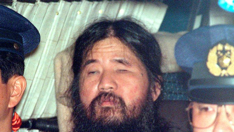 Japanese doomsday cult leader Shoko Asahara sits in a police van following an interrogation in Tokyo, Japan, in this photo taken by Kyodo September 25, 1995. Mandatory credit Kyodo/via REUTERS ATTENTION EDITORS - THIS IMAGE WAS PROVIDED BY A THIRD PARTY. MANDATORY CREDIT. JAPAN OUT. NO COMMERCIAL OR EDITORIAL SALES IN JAPAN.
