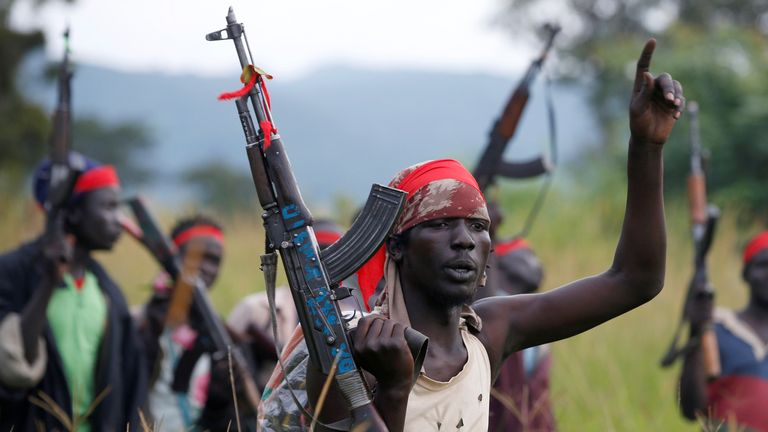 SPLA-IO (SPLA-In Opposition) rebels hold up guns in Yondu, the day before an assault on government SPLA (Sudan People's Liberation Army) soldiers in the town of Kaya, on the border with Uganda, South Sudan, August 25, 2017. REUTERS/Siegfried Modola