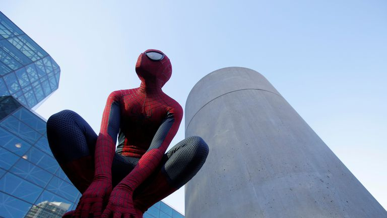 A man in a Spiderman costume poses at New York Comic Con in Manhattan, New York