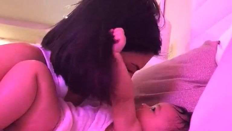 Stormi gives mum's hair a tug, and gets a big kiss in return