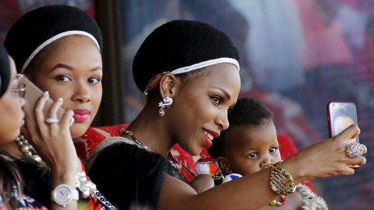 One of King Mswati's 15 wives takes a selfie in August 2015