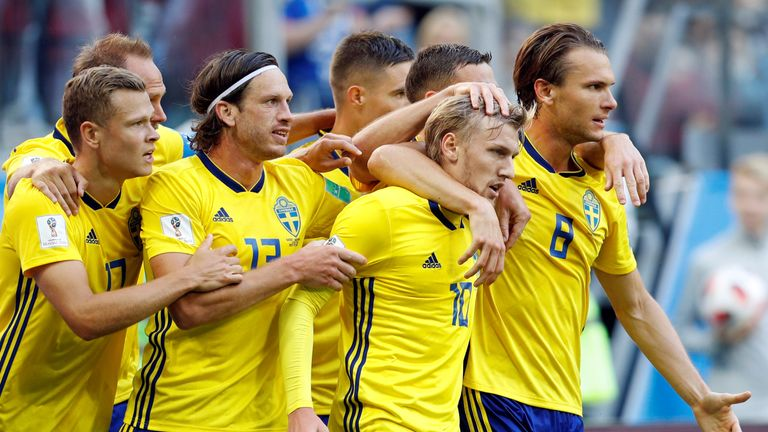Emil Forsberg is mobbed by his teammates after putting Sweden 1-0 up