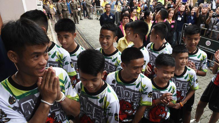 The 12 boys and their football coach Ekkapol Chantawong