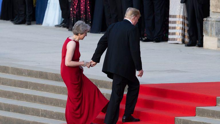 Theresa May and Donald Trump hold hands