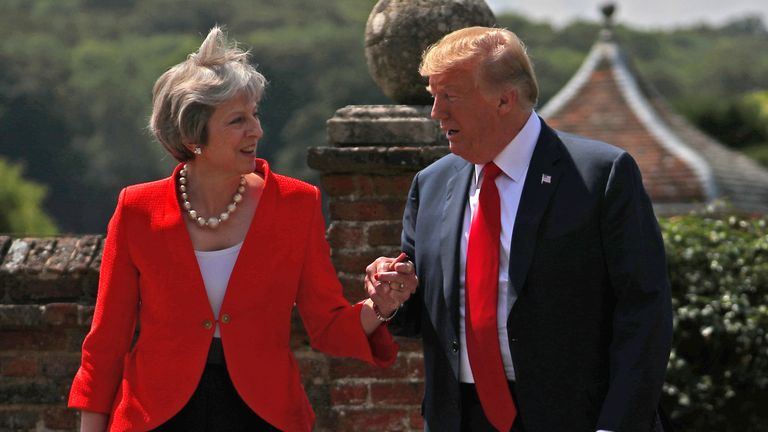 Britain's Prime Minister Theresa May and U.S. President Donald Trump walk to a joint news conference at Chequers, the official country residence of the Prime Minister, near Aylesbury, Britain, July 13, 2018