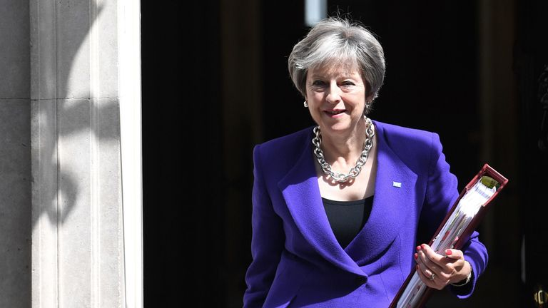 Theresa May leaves Downing Street for the Commons to face Prime Minister's Questions