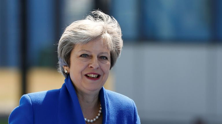 Theresa May arrives at the Alliance's headquarters ahead of the NATO summit in Brussels