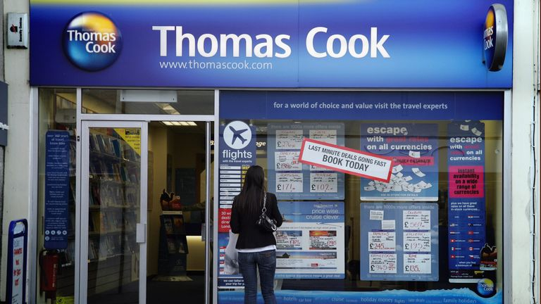 BRISTOL, UNITED KINGDOM - AUGUST 13: A woman looks at holidays for sale in a Thomas Cook travel agent window in Keynsham on August 13, 2008 in Bristol, England. The chain of travel agents has reported robust bookings for this summer and for 2009 as people choose to escape the miserable summer weather and the economic slump. (Photo by Matt Cardy/Getty Images)
